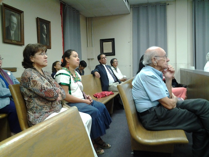 Concerned citizens wait for Judge David Canales's decision on whether or not to continue pre-trial for the Hays Street Bridge property use trial. Photo by Adrian Ramirez.