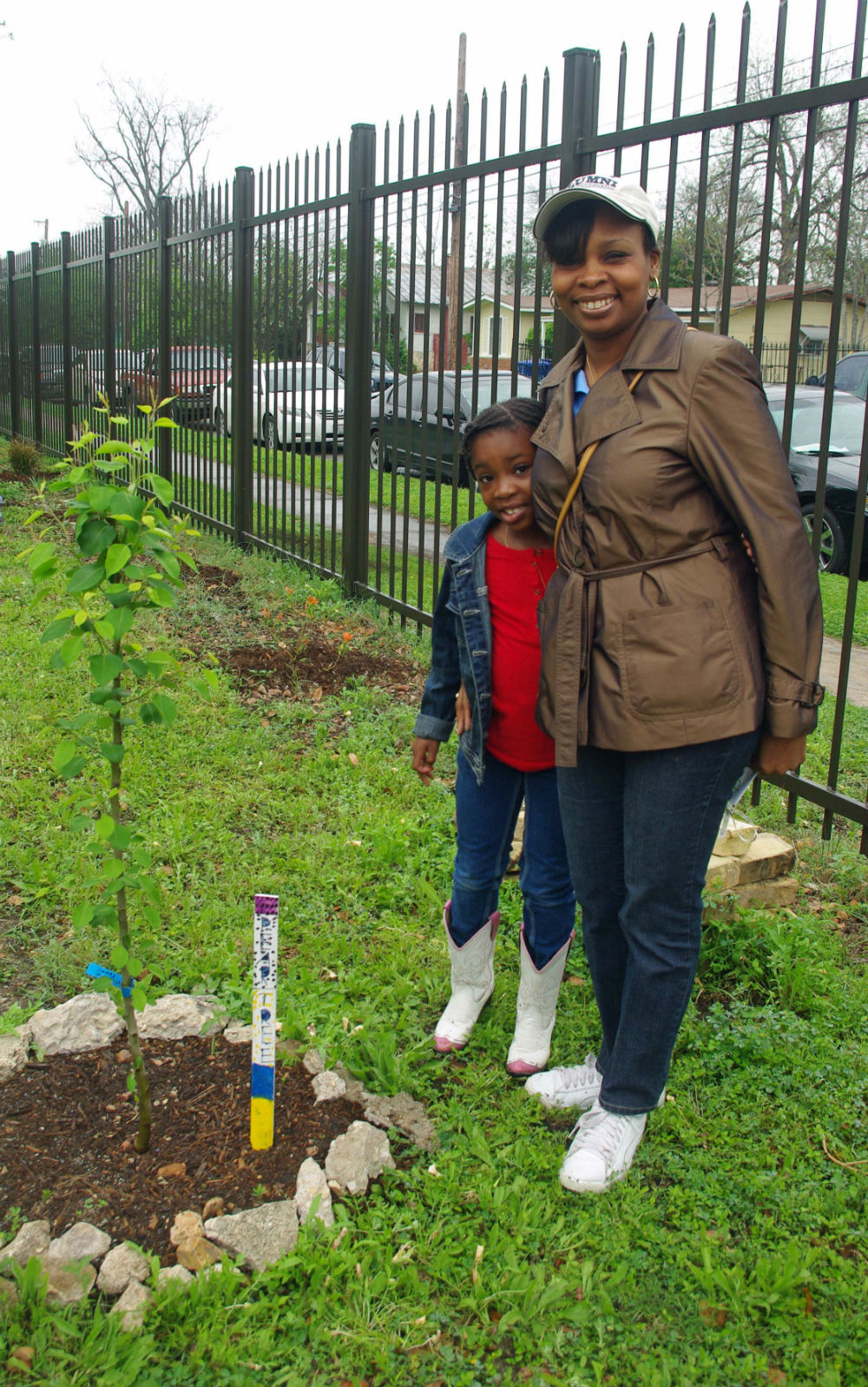 Ivy Taylor with daughter Morgan at the Eastside Sprout Community Garden. Photo by Juan Garcia.