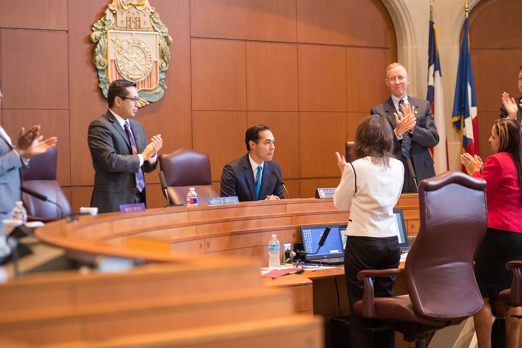 City staff and Council members lead the Council chambers in standing ovation in praise of outgoing Mayor Julián Castro. Photo by Scott Ball.