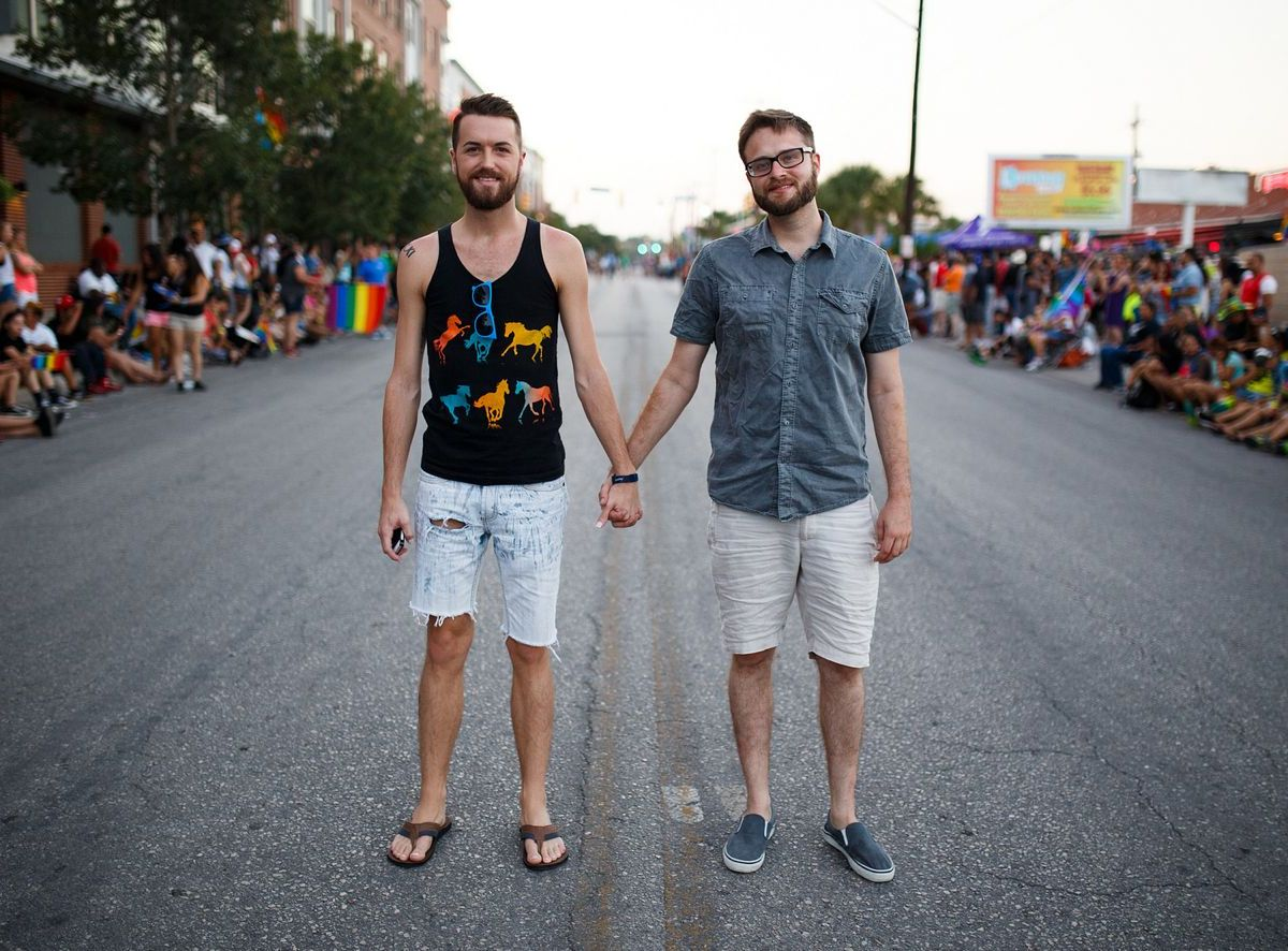 "Joseph Polasek and Samuel Duplechain at the 2014 Pride ""Bigger Than Texas"" Parade. Photo by Scott Ball."