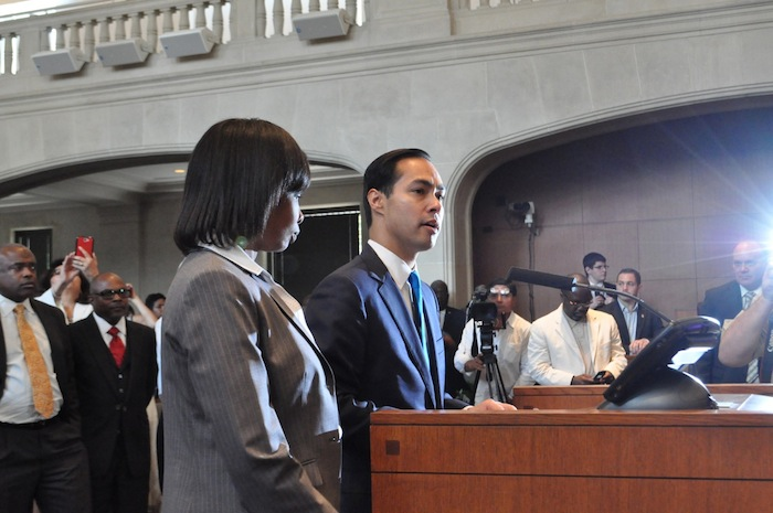 Mayor Julián Castro hands over his official letter of resignation and welcomes incoming Mayor Ivy Taylor. Photo by Iris Dimmick.