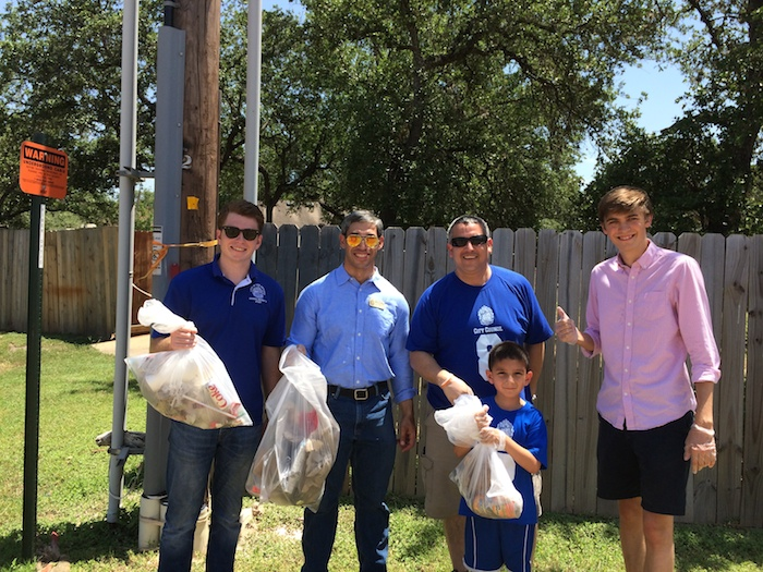 Local residents and District 8 Councilman Ron Nirenberg (center, left) pose for a photo while picking up trash during the mid-summer barbecue at Bonnie Conner Park. Photo by H. Drew Galloway.
