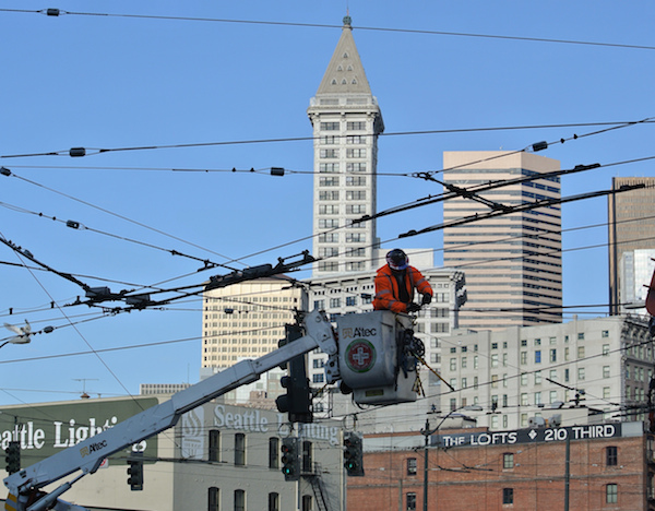A worker adjusts electric lines for the future streetcar line in Capitol Hill, Seattle. Photo courtesy of the Seattle Department of Transportation.