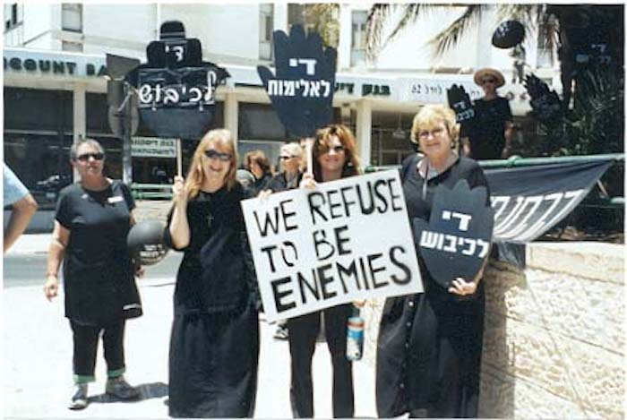 (From left) Sister Martha Ann Kirk, a new friend, and Jessica Kimmel at a Women in Black demonstration in Jerusalem with Israeli and Palestinian women who refuse to be enemies. Photo courtesy of Sister Martha Ann Kirk.