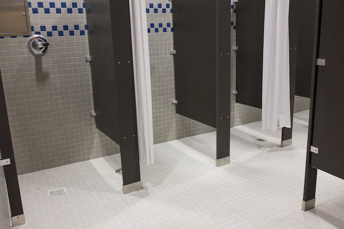 Private showers in the athlete locker rooms at Alamo Stadium. Photo by Scott Ball.