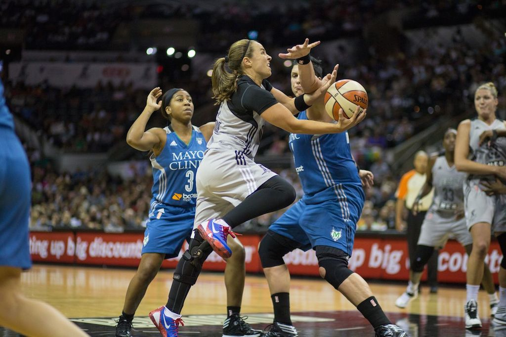 Becky Hammon drives the paint to avoid multiple defenders during her last San Antonio Stars game. Photo by Scott Ball.