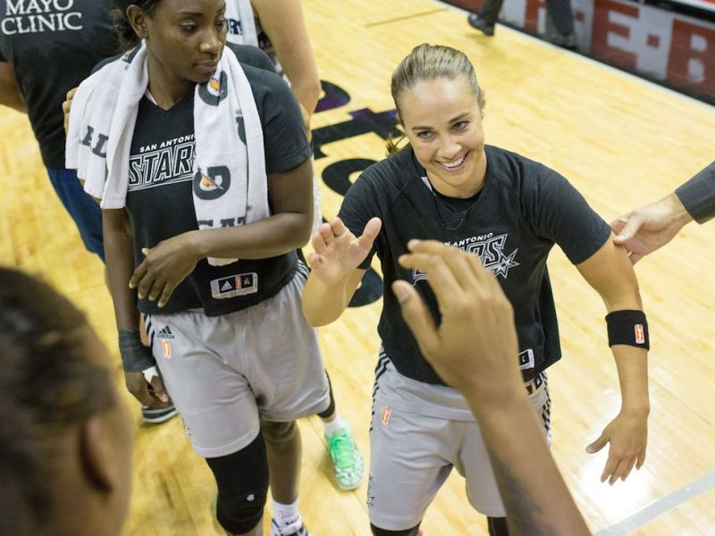 Becky Hammon is congratulated by the Minnesota Lynx team after a San Antonio Stars win Friday night. Photo by Scott Ball.