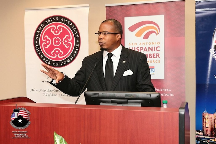 Christopher C. Herring addresses the audience gathered at St. Philip's College for a chamber welcome reception for Mayor Ivy Taylor. Photo courtesy of Melendrez Entertainment.