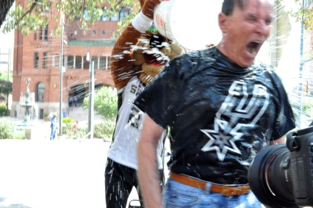 Bexar County Judge Nelson Wolff reacts to the ice bucket challenge. Photo by Iris Dimmick.