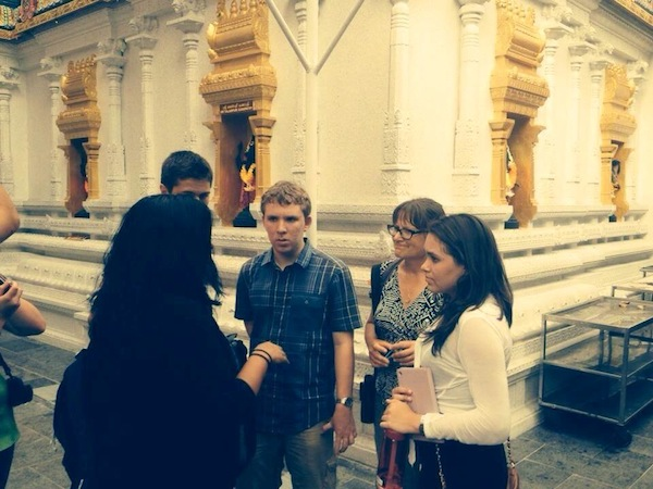 AYLP students listen to educator Nilam Patel speak about Hinduism in the Sri Veerama Kaliamman Temple located in Singapore's Little India. Photo by Dan Ewert.