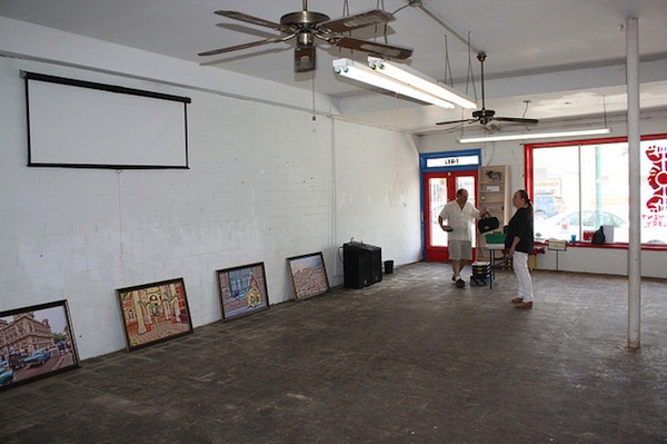 Organizers of Eric Lane's exhibit at the Movement Gallery work Wednesday to help prepare for the event. Photo by Kay Richter.
