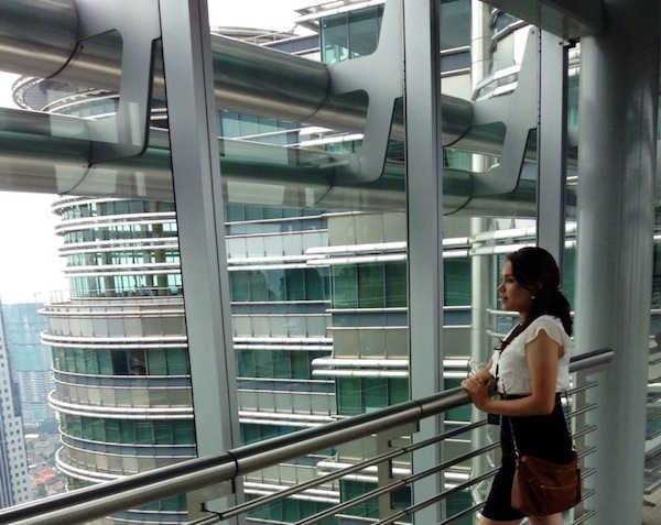 Observing Kuala Lumpur from the skybridge in the Petronas Towers. Photo by Grant Leroy.