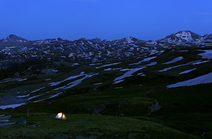 RIO GRANDE NATIONAL FOREST, CO - The Disappearing Rio Grande Expedition camp at Stony Pass (12,800 ft), the headwaters of the Rio Grande River on the Continental Divide in the Rio Grande National Forest near Creede, Colorado JUNE 20, 2014. CREDIT: Erich Schlegel/Disappearing Rio Grande Expedition