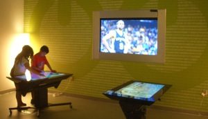 A boy and a girl play an electronic game at a table in the children's room at BiblioTech. Photo by Lily Casura.