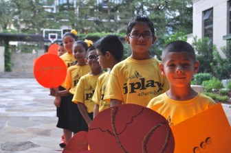 A troop of children participating in I Play, Afterschool –a program of San Antonio Sports – gather to greet the NCAA Committee delegates. Photo by Iris Dimmick.