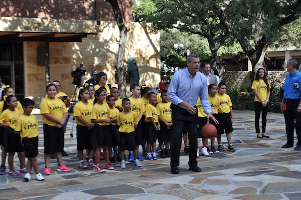 Chairman of this year's NCAA Commmittee Scott Barnes shoots some hoops with Sean Elliot in the courtyard of the Briscoe Western Art Museum. Photo by Iris Dimmick.