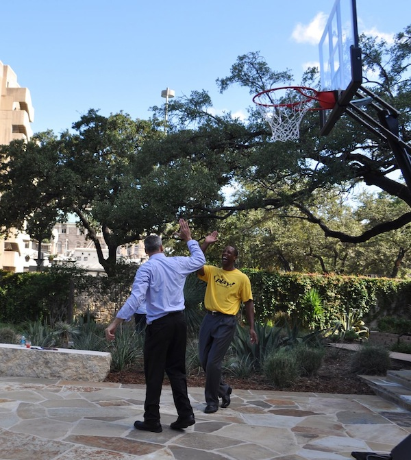 Sean Elliot shoots some hoops with Chairman of this year's NCAA Commmittee Scott Barnes in the courtyard of the Briscoe Western Art Museum. Photo by Iris Dimmick.