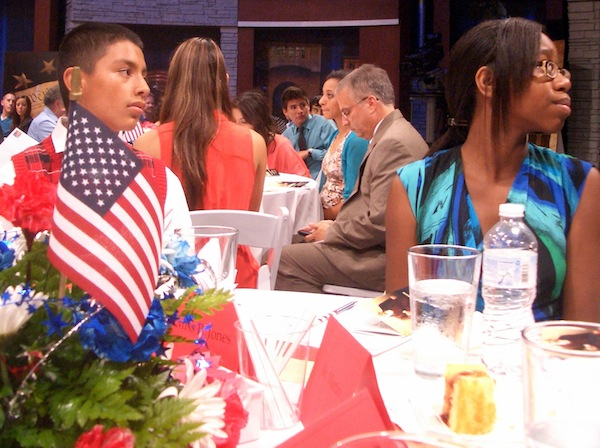 Students listen to a speaker as Chris Phillips looks over his notes at the Constitution Café event. Photo by Lily Casura.