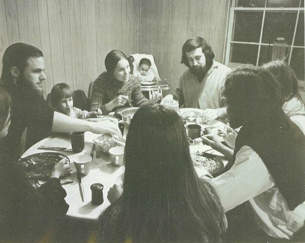 Vintage: CIS Founder Bill Milliken and other CIS Founders chew on dinner and solutions to #ChangeThePicture of education in America. Courtesy photo.