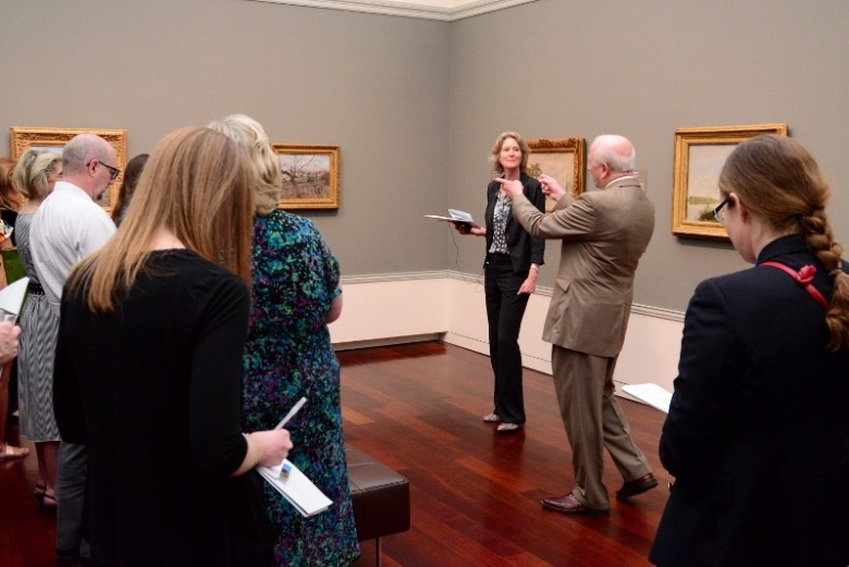 Morton and Chiego discuss Pissarro landscapes. Photo by Page Graham.