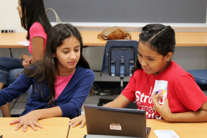 Working together at a Girls Inc. of San Antonio Made with Code party. Photo by Tabitha Ford.