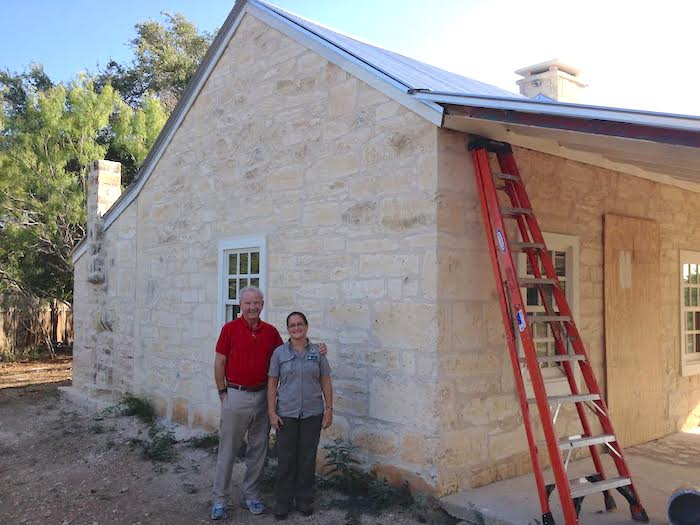 Former Mayor Phil Hardberger with Gail Gallegos, nature preserve officer at Hardberger Park, outside the restored 1800s-era homestead. Photo by Robert Rivard.
