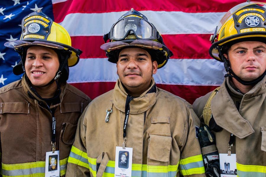 From left: San Antonio Firefighters Cantu, Martinez, and Tilley pose a photo during the 2014 San Antonio 110 9/11 Memorial Climb. Photo by Scott Ball.