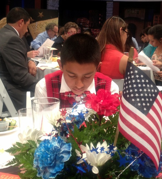 East Central ISD student pores over his copy of the Constitution to prepare for discussion. Photo by Lily Casura.