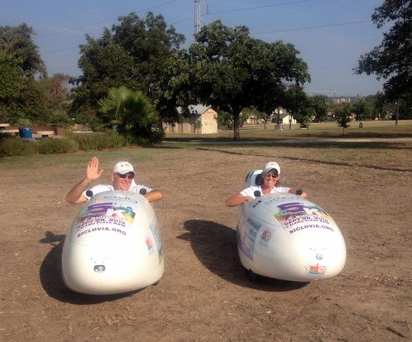 San Antonio Bike Tours staff show off two recumbent trikes at Síclovía event. Photo by Lily Casura.