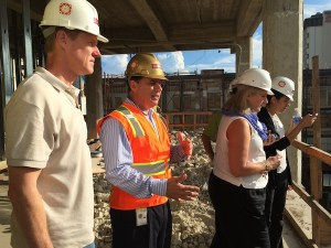 Rivercenter Mall General Manager Chris Oviatt (center) speaks with Centro San Antonio tour guests in the Joske's construction site.