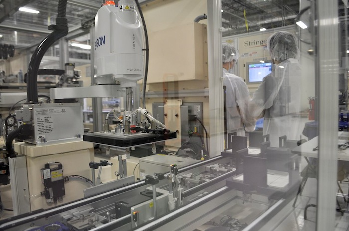 The panel assembly is more automated than the solar cell wafer line. Mission Solar Energy manufacturing plant. Photo by Iris Dimmick.