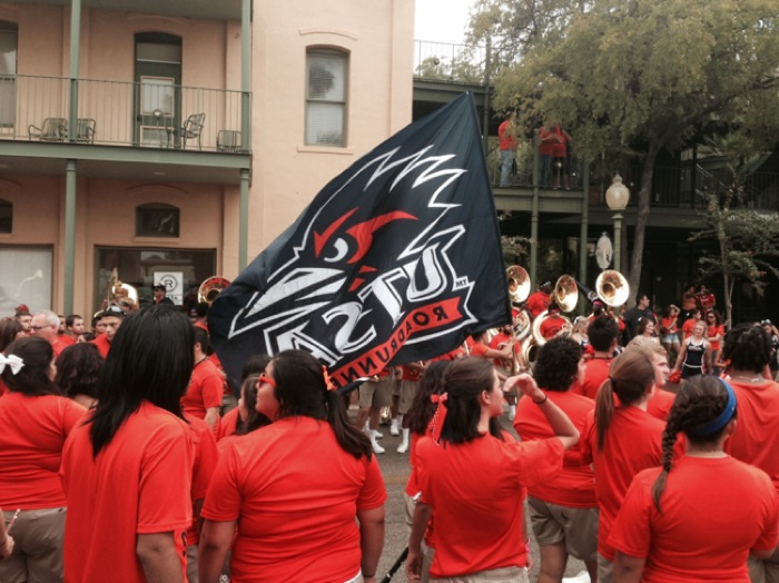 UTSA students proudly wave their school banner.