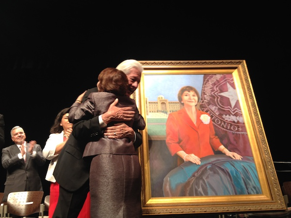 Noted San Antono artist Lionel Sosa embraces Pres. Ferrier after unveiling of her official portrait. Photo by Robert Rivard.
