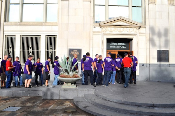 Police and fire union members line up to enter City Council chambers during the 2015 budget vote. Photo by Iris Dimmick.