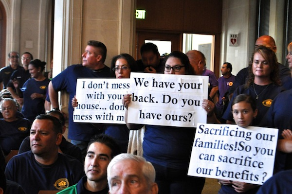 Police and fire union members gather in City Council chambers during the 2015 budget vote. Photo by Iris Dimmick.
