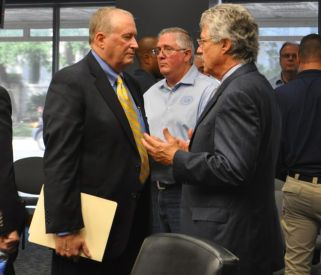 SAPOA attorney Ron DeLord (left) and City attorney Jeff Londa speak briefly one-on-one after the meeting. Photo by Iris Dimmick.