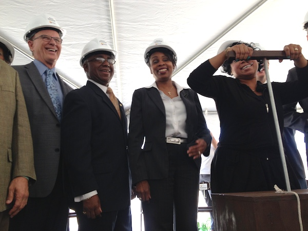 From left: Bexar County Judge Nelson Wolff, District 2 Councilmember Keith Toney, Mayor Ivy Taylor, Wheatley Courts resident LaShawn Robertson, and U.S. Rep. Lloyd Doggett celebrate the demolition of Wheatley Courts with a symbolic push of at dynamite plunger, releasing confetti. Photo by Robert Rivard.