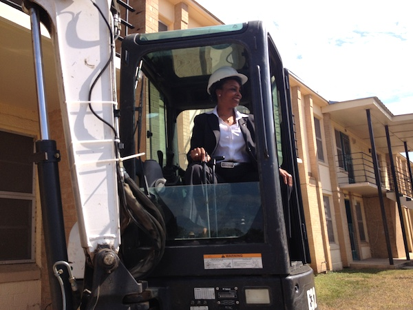 Mayor Ivy Taylorsits in a backhoe at Wheatley Courts on demolition day. Photo by Robert Rivard.