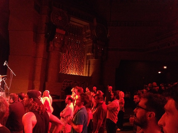 The audience watches Bad Plus jazz band on stage at the Aztec Theatre. Photo by Adam Tutor.