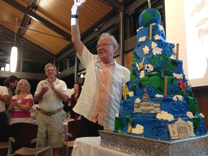 Former Mayor Phil Hardberger cuts into his 80th birthday cake. Photo by Robert Rivard.