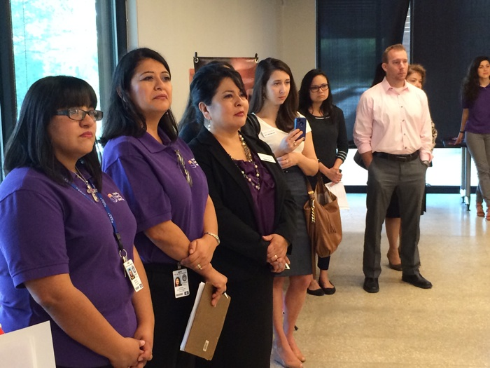 Guests listen intently about an announcement of a $9.5-million grant to the San Antonio Metro Health District. Photo by Katherine Nickas.