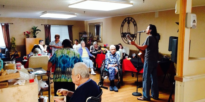 A M.U.S.I.C Project performer plays for senior citizens. Courtesy photo.