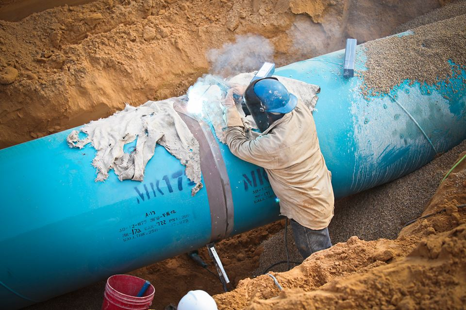 A worker installs a portion of pipeline. Photo courtesy of SAWS Facebook page.
