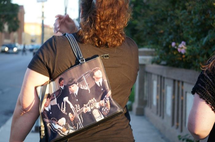 A fan walks to the Paul McCartney show at the Tobin Center. Photo by Alan Weinkrantz.