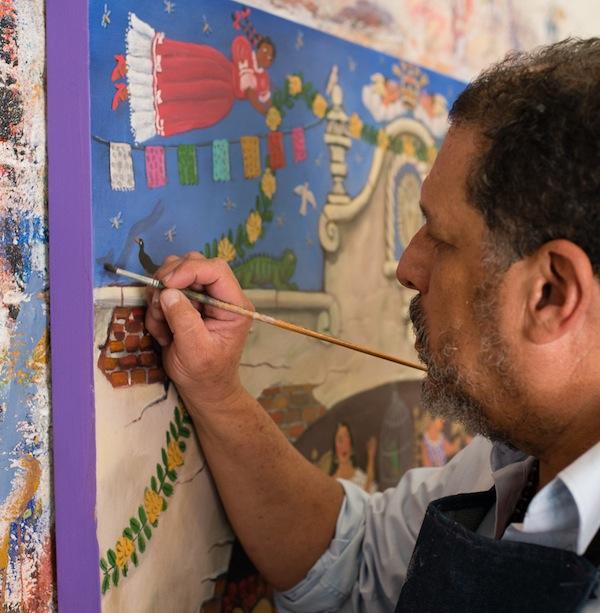 Raymundo Gonzalez painting the walls of his living room. Photo by Mark Menjivar.