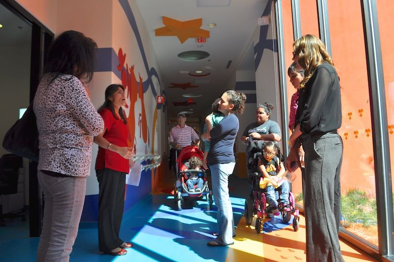 Families are led on tours of CRIT USA after the grand opening ceremony. Photo by Iris Dimmick.