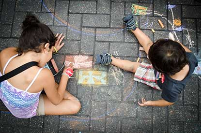 Two children drawing in the Chalk It Up Freestyle Zone. Photo by Francisco Cortes.