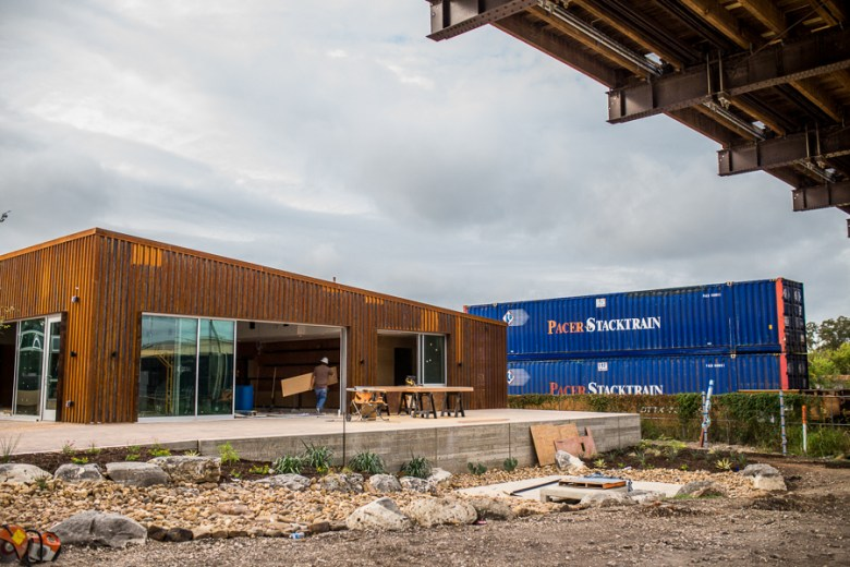 A train passes by the beer hall building at Alamo Beer Company. Photo by Scott Ball.