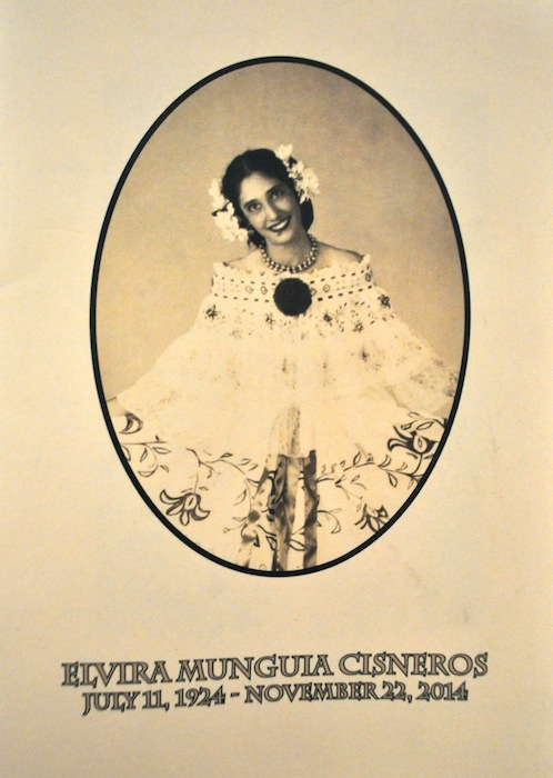 The program cover for Elvira Munguia Cisneros' (1924 - 2014) Catholic funeral Mass.   She crafted the dress she is wearing in this photo.