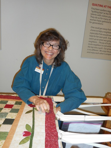 Gail Dickman enjoys the quilting process and the company of other 'Bees.' Photo by Don Mathis.